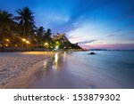 hua hin beach at twilight with... | Shutterstock . vector #153879302