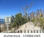Small photo of A keep off the dunes sign at Shinnecock East County Park in Southamtpon, Long Island, New York.
