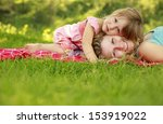 a young mother and her little... | Shutterstock . vector #153919022