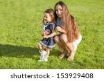 mother and daughter in the park ... | Shutterstock . vector #153929408