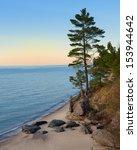 Tall Pine Tree Sunset On Lake...
