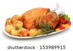 roast chicken on white dish | Shutterstock . vector #153989915