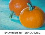 two halloween pumpkins on blue... | Shutterstock . vector #154004282