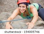 Happy Girl Climbing Rock Face...