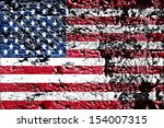 flag of usa painted on cracked... | Shutterstock . vector #154007315