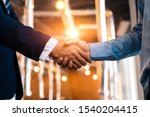 Small photo of Business shaking hands, finishing up meeting. Successful businessmen handshaking after good deal.