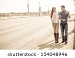 young couple walking and... | Shutterstock . vector #154048946