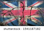 Small photo of barbed wire in front of an old stained dirty union jack british flag with dark crumpled edges brexit freedom of movement isolationist concept