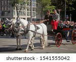 Small photo of MUNICH, GERMANY - SEPTEMBER 22, 2019 Grand entry of the Oktoberfest landlords and breweries, festive parade of magnificent decorated carriages and bands. Carriage of brewery landlord with white horses