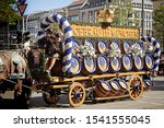 Small photo of MUNICH, GERMANY - SEPTEMBER 22, 2019 Grand entry of the Oktoberfest landlords and breweries, festive parade of magnificent decorated carriages and bands. HB brewery carriage with beer barrels