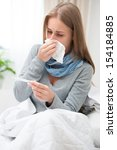 sick woman with thermometer in... | Shutterstock . vector #154184885