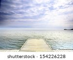 old wooden empty pier jetty at... | Shutterstock . vector #154226228