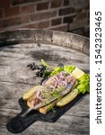 Stock photo dutch style herring with dill red onion and red pepper 1542323465