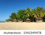 vintage wooden huts on sand at... | Shutterstock . vector #1542349478