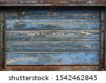 Vintage wooden board with blue peeling paint in a frame - stock photo