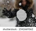 The Girl Throws A Snowball At...