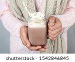 Woman Holding Mason Jar Of...