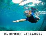 Happy Little Kid In Snorkeling...