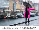 Young Woman In Pink Coat Dance...