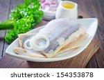 Stock photo herring on white plate 154353878