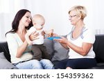 a grandmother feeding the baby... | Shutterstock . vector #154359362