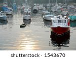 Fishing Boats In A Harbor In...