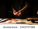 Closeup Of Chef Hands Preparin...