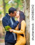 couple kissing outdoor in the... | Shutterstock . vector #154380242