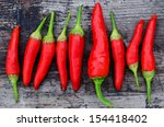 red chili peppers on an old... | Shutterstock . vector #154418402