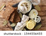 Stock photo recipe for marinated herring with onions vinegar spices in oil in a bank close up on the table 1544556455