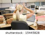 Businesswoman In Cubicle With...