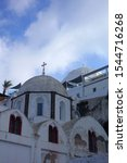Picturesque landmark orthodox church of Ypapanti in beautiful village of Fira overlooking the caldera, Santorini island, Cyclades, Greece