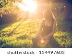 girl in the garden at golden... | Shutterstock . vector #154497602