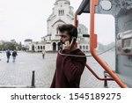 Young Man Making A A Call In A...
