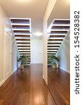 Bright space - a modern stairway with a big mirror - stock photo