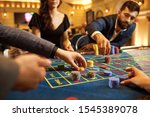 A Group Of People Gamblers...