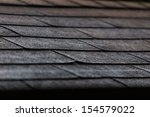 black shingles on a roof in... | Shutterstock . vector #154579022