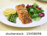 Baked salmon with green salad and asparagus - stock photo