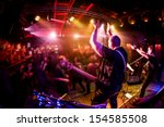 band performs on stage  rock... | Shutterstock . vector #154585508