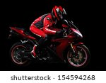 Motorcyclist In Red Equipment...