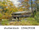 Covered Bridge And Autumn...