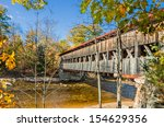 Covered Bridge And Fall Foliag...
