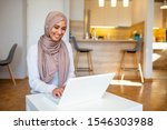 Muslim Woman Working With...