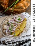 Stock photo  traditional russian appetizer herring and boiled potatoes with fresh onions sprinkled with butter 1546423955