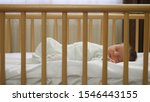 Newborn Child Sleeping In A...