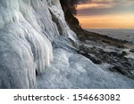 Frozen Waterfall And Sea