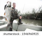 Amateur Angler Stands In The...