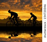 Silhouette Of The Cyclists...