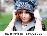 young woman wearing knitted hat | Shutterstock . vector #154726928