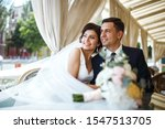 young bride and groom in a cafe.... | Shutterstock . vector #1547513705